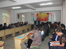 Clean energy advocates of Fuyuan County in Yunnan conducting community educational activities on clean energy at the office of the village committee, with the support from PCD.