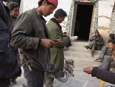 In Jiangpo Village in Deqin County of Yunnan Province in China, PCD supports the protection of wildlife. Activities include patrolling the mountains, and after the patrolling the villagers remove animal traps such as the wire snare in the hands of the man on the left.