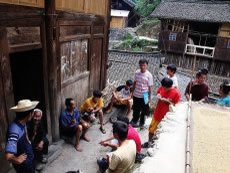 Miao youngsters, with paper and pens in their hands, interview their elders about the Miao's migration history.