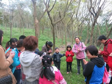 Parents and children taking part in Affective Nature Education activities run by partner in Guangxi.