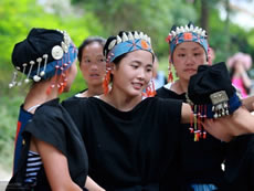 As a performer of the Ecological Museum, Wang Caihin (middle) who is also an intern of a PCD-supported programme to conserve local culture, dresses up for traditional Yao dance to welcome visiting tourists.